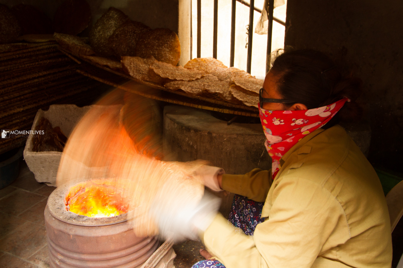 Lady drying rice cracker